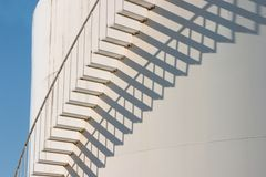 Shadow and stairs in color. Stairs and shadow in color with the sky peeking out on the side Royalty Free Stock Image