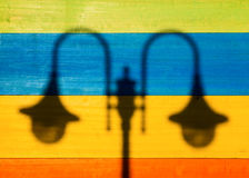 Shadow of Street Lamps on Colored Wooden Background Stock Images