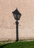 Shadow streetlamp. The shadow of a street lamp on the wall of the Peter and Paul Fortress Royalty Free Stock Photography