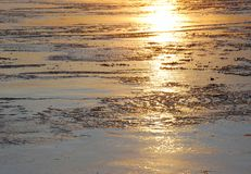 Shadow of Sunset on the ice lake Stock Photo