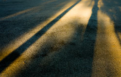 Shadow of sunset. Shadow of sunset reflective on running track in public park, in the dark tone effect Royalty Free Stock Photo