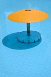 Shadow of sunshade in swimming pool Stock Image