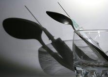 Shadow of syringe Royalty Free Stock Image