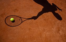 Shadow of a tennis player Royalty Free Stock Photo