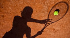 Shadow of a tennis player Royalty Free Stock Image