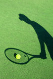 Shadow of a tennis player Royalty Free Stock Images
