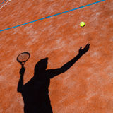 Shadow of a tennis player in action Stock Photo