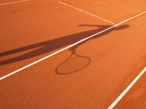 Shadow of a tennis player Stock Photography