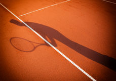 Shadow of a tennis player Royalty Free Stock Photos