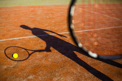 Shadow of a tennis player in action Stock Image