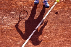 Shadow of a Tennis Player on a Clay Tennis Court Royalty Free Stock Photo