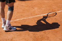 Shadow of a tennis player on court Royalty Free Stock Images