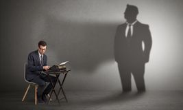 Shadow threatening hard worker man royalty free stock images