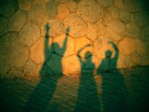 Shadow of three dancing ghosts Royalty Free Stock Photos