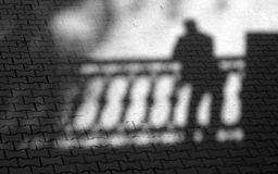 Shadow of the tired person. Royalty Free Stock Photo