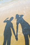 The shadow of two women at the beach Royalty Free Stock Images