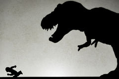 Shadow of tyrannosaurus chasing human  on wall. No logo or trademark Stock Images