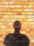 Shadow wall bricks person Royalty Free Stock Photo