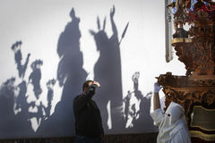 Shadow on a wall of a throne during a Holy week procession Royalty Free Stock Photo