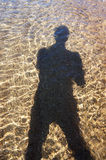 Shadow on the water Royalty Free Stock Image
