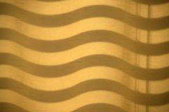 Shadow waves on a curtain stock image