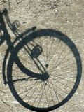 Shadow wheel. The bicycle in outdoor Stock Photography