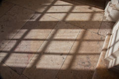 Shadow from a window on a marble floor Stock Photos