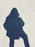 Shadow of a woman on concrete background Stock Photo