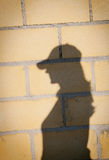 Shadow of a woman with hat on a wall Royalty Free Stock Photo