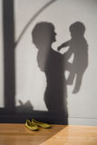 Shadow of a woman holding a baby Royalty Free Stock Image