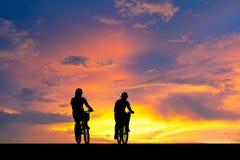 Shadow of woman riding bike. Stock Photo
