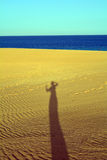 Shadow of woman on the sands dunes Corralejo Fuerteventura Royalty Free Stock Photo