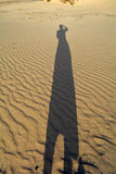 Shadow of woman on the sands dunes Corralejo Fuerteventura Stock Photo