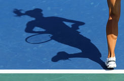 Shadow of woman tennis player Stock Images