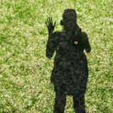 Shadow of a woman waving her hand Royalty Free Stock Image