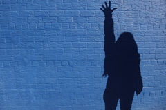 Shadow women on the wall Stock Photos