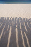 Shadow of wooden shelter on the beach near Stock Images