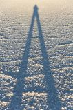 Shadow in the world`s largest salt flat, Salar de Uyuni in Bolivia, photographed at sunrise Stock Image