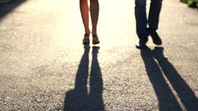 Shadow of a young couple in love on the pavement. Silhouette of two people stock video footage