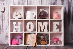 Shadowbox home. Shadow box with wooden letters home and cozy things Stock Images