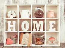 The Shadowbox home. Shadow box with wooden letters home and cozy things Stock Photography