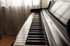 Shadowed piano key Stock Photography