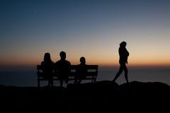 Shadowgraph sur un coucher du soleil Photographie stock