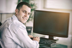 Shadowing a smiling businessman Royalty Free Stock Image