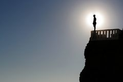 Shadows. A man pepares to jump off a cliff in Mazatlan, Mexico Stock Images