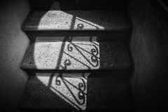 Shadows. Of geometric figures on stairs Royalty Free Stock Photo