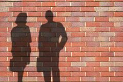 Shadows. Of people on wall royalty free stock photo