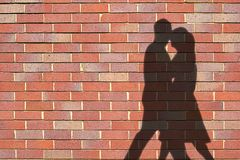 Shadows. Of couple against wall stock images