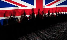 Shadows against UK flagged screen. Lot of people shadows against UK flagged screen, Brexit concept stock photos