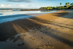 Shadows on the beach at sunset in Australia stock images